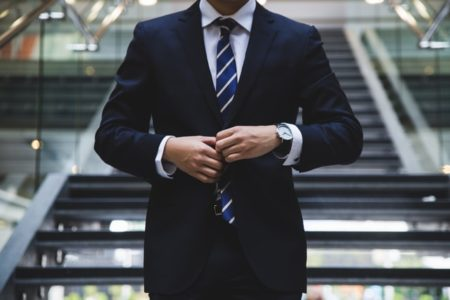 businessman in suit wearing a watchinvestment watches