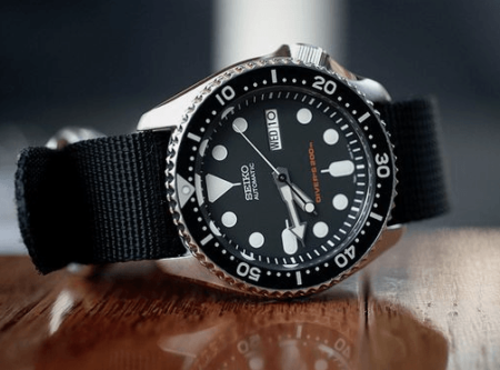 Seiko SKX007 200m Diver Men Watch on a wooden surface