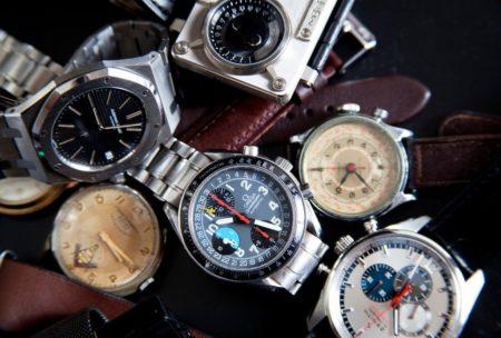 6 watches in a watch pile omega audemars piguet zenith